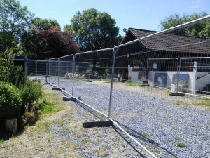 Fencing has been put in place to protect the public from construction vehicles